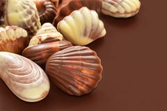 Praline. The chocolate pralines on the brown background Stock Images