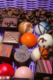 Chocolate pralines and coffee beans in lavender basket Royalty Free Stock Photo