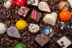 Chocolate pralines and coffee beans Royalty Free Stock Images