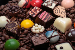 Chocolate pralines and coffee beans Royalty Free Stock Photos