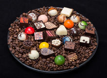Chocolate pralines and coffee beans Stock Image