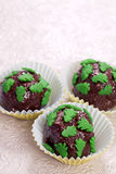 Chocolate pralines with green christmas trees Royalty Free Stock Photo