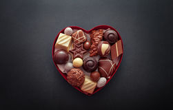 Chocolate pralines in heart shape box Stock Photography