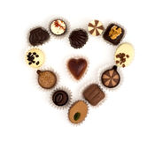 Chocolate pralines in heart shape on a white background Royalty Free Stock Photos