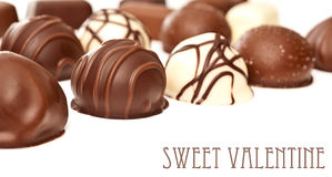 Chocolate pralines isolated on white Stock Images