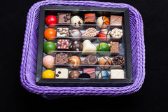 Chocolate pralines in lavender basket Royalty Free Stock Photography
