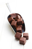 Chocolate pralines on metal scoop Royalty Free Stock Photos