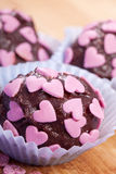 Chocolate pralines with pink hearts Royalty Free Stock Photo