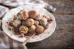 Chocolate pralines in the plate Stock Photography