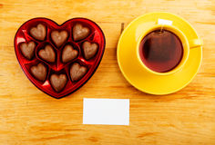 Chocolate pralines in red heart shape Royalty Free Stock Images