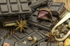 Chocolates and candies on a wooden background close-up. Royalty Free Stock Image