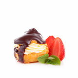 Chocolate profiterole. And berry isolated Royalty Free Stock Photo