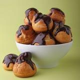 Chocolate profiteroles Stock Images