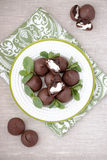 Chocolate profiteroles with cottage. Royalty Free Stock Photos