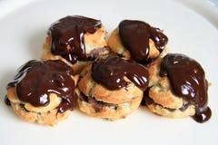 Chocolate profiteroles. Profiteroles, delicious French chocolate cakes Royalty Free Stock Photo