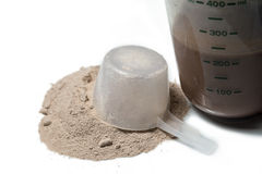 Chocolate protein shake with a upturned scoop  Royalty Free Stock Photo