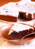 Chocolate and prune cake with white glaze Stock Images