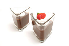 Chocolate pudding. Isolated photo of chocolate pudding with one strawberry on white Stock Image