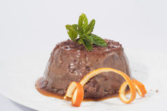 Chocolate pudding decorated with mint and orange peel Royalty Free Stock Photo