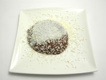 Chocolate pudding with grated coconuts Stock Photography
