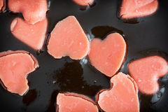 Chocolate pudding with little hearts of marzipan Stock Images