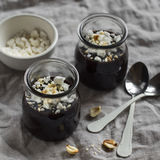 Chocolate pudding with nuts in glass jars Royalty Free Stock Image