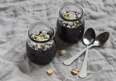 Chocolate pudding with nuts. On a grey surface Stock Image