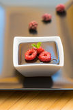Chocolate pudding with raspberries and mint Royalty Free Stock Photo