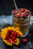 Chocolate pudding with strawberries and a clear glass royalty free stock images