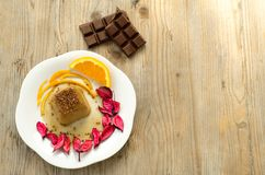 Chocolate pudding on table wood. Delicious chocolate dessert on table wood,seen from above Stock Image