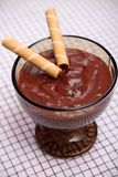 Chocolate pudding with waffle rolls Stock Photo