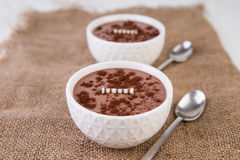 Chocolate pudding in white bowls Stock Image