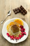 Chocolate pudding on wood background. Delicious chocolate dessert on porcelain plate Stock Photos
