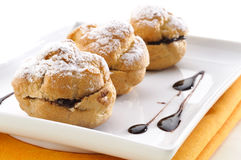 Chocolate puff with icing sugar Stock Photography