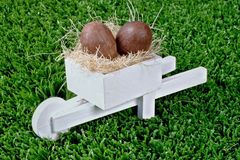 Chocolate and pushcart. Easter time: Chocolate and pushcart royalty free stock image