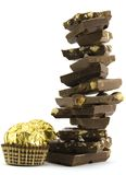 Chocolate pyramid and two gold balls. On white Stock Photo