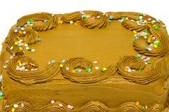 Chocolate que hiela en la torta Foto de archivo