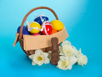 Chocolate rabbit, white narcissuses and a basket Royalty Free Stock Images