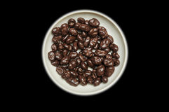 Chocolate raisins in bowl Stock Images