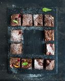 Chocolate and raspberry brownie squares on black Royalty Free Stock Images