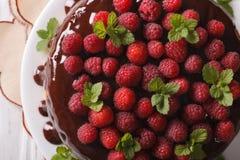 Chocolate raspberry cake close up on a plate. horizontal top vie Stock Photos