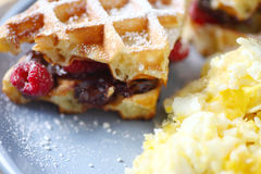 Chocolate and raspberry waffle sandwiches with eggs Stock Photography