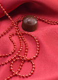 Chocolate and red beads Stock Images