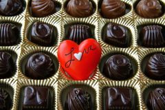 Chocolate with a red heart Royalty Free Stock Photo