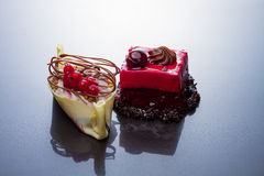 Chocolate, redcurrant and cherry cakes Stock Photo