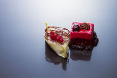 Chocolate, redcurrant and cherry cakes Stock Image