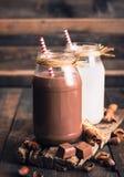 Chocolate and regular milk Stock Photo