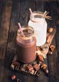 Chocolate and regular milk Royalty Free Stock Image