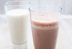 Chocolate and regular milk horizontal Royalty Free Stock Photo