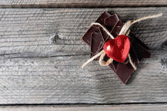 Chocolate with ribbon and heart on St. Valentine`s day love. Royalty Free Stock Photography
